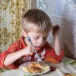 The boy has dinner — Stock Photo