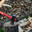 Stock Photo: Axe and woodpile.