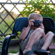 The boy with a camera — Stock Photo