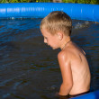 The boy in inflatable pool. — Stock Photo