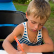 Stock Photo: The little boy studies to write