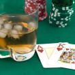 Counters of card and glass of whisky — Stock Photo #1032899