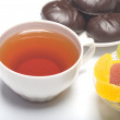 Stock Photo: Cup with tea, zephyr and fruit candy.