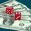 Money and dice. — Stock Photo #1035641