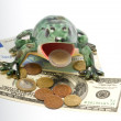 Royalty-Free Stock Photo: Ceramic frog and money.