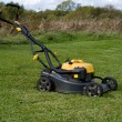 Stock Photo: Petrol lawn mower.