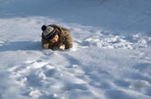 The boy plays to snow — Stock Photo