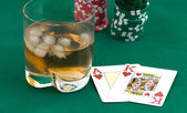 Counters of a card and a glass of whisky — Stock Photo