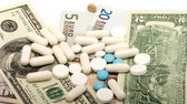 Medications and money. — Stock Photo