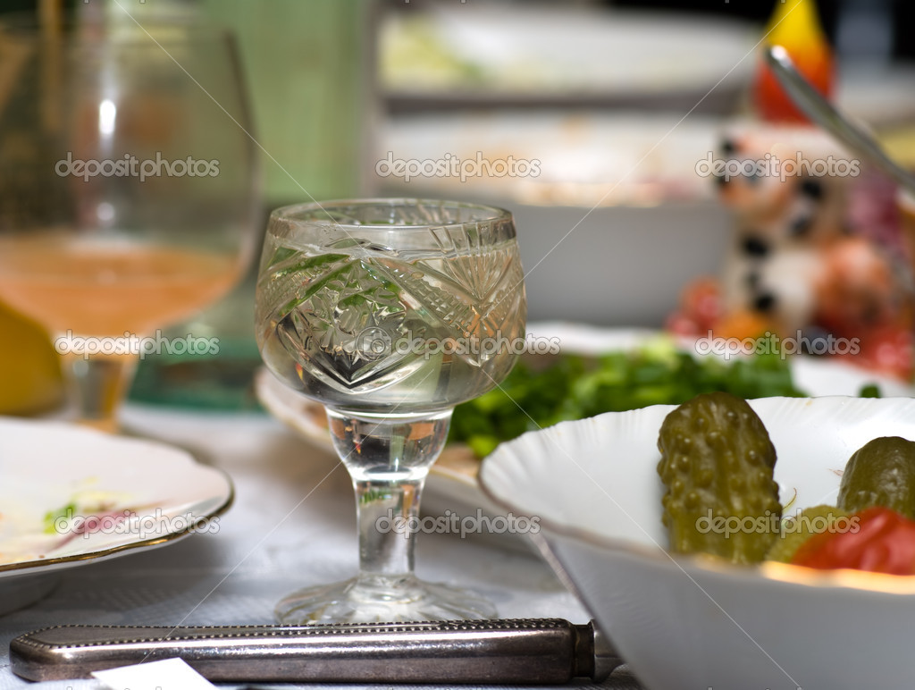 Vodka wine-glass on a table with snack — Stock Photo #1032906