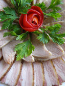 Cold baked pork decorated with tomato — Stock Photo