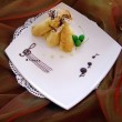 Dish with pancakes on tablecloth — Stock Photo #1031232