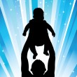 Silhouette of father of holding chi — Stock Photo #1024873