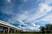 Urban landscape with highway and clouds — Stock Photo
