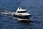 Fast white motor boat on blue water — Stock Photo
