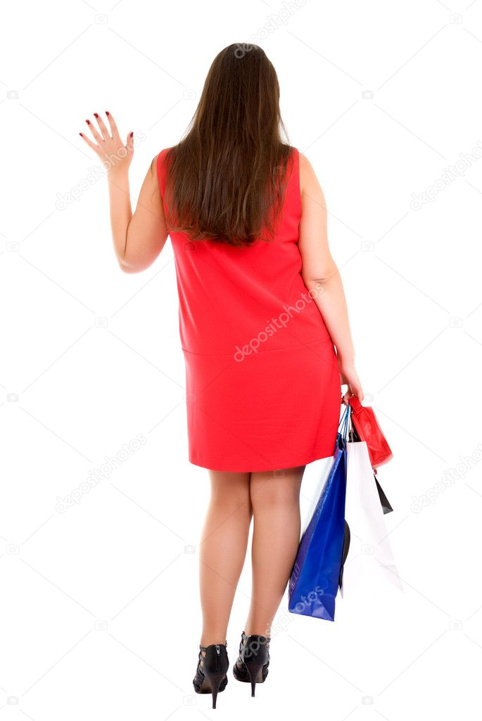 Shopping woman with bags gives a wave goodbye — Stock Photo #1021844
