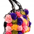 Female bag with artificial flowers — Stock Photo