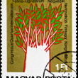 Postage stamp show unusual painting tree — Stock Photo