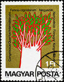 Postage stamp show unusual painting tree — Stockfoto