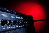 Combo amplifier on red background — Stock Photo