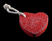 Red heart-shaped stone with rope — Stock Photo