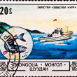 Postage stamp shows boat and fish - Stock Photo