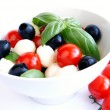 Mozzarella, black olives and tomato sala — Stock Photo
