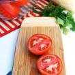 Ripe sliced tomatoes on a wooden board — Stock Photo
