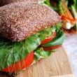 Healthy rye bread-tomato sandwich on w — Stock Photo #1032782