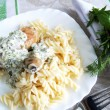 Chicken legs with pasta with herbal crea - Stock Photo