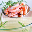 Boiled shrimps with dill - Stock Photo