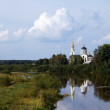 Russian orthodox church on a river bank - Stock Photo