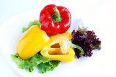 Red and yellow sweet peppers — Stock Photo