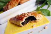 Bitten puff-pastry pasty filled in fresh — Stock Photo