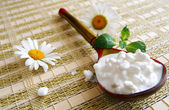 Wooden spoon with cottage cheese — Stock Photo