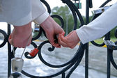 Newly-married padlock their love — Stock Photo