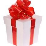 weiße Geschenkbox und roten Bogen — Stockfoto