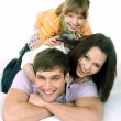 Happy family on white bed. — Stock Photo