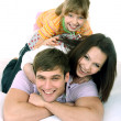 Stock Photo: Happy family on white bed.