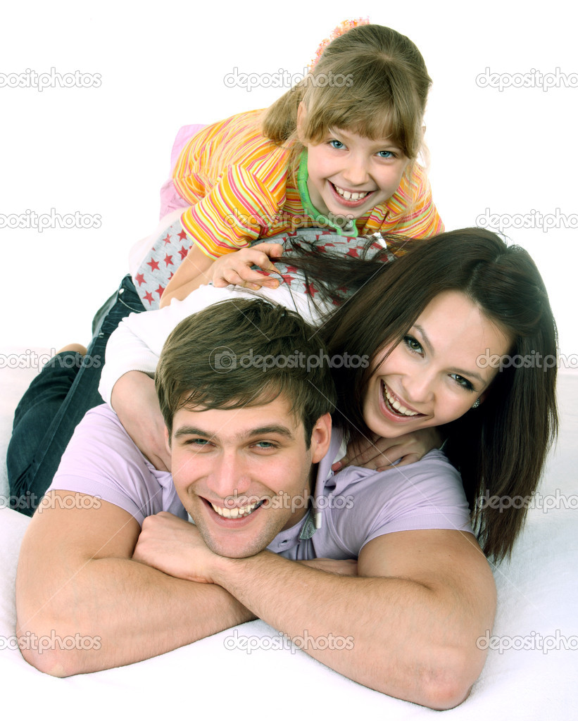 Happy family on white bed. Isolated. — 图库照片 #1026551
