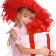 Girl in the red hat and the box. — Stockfoto