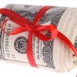 Roll dollars with red bow. — Stock Photo