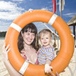 Royalty-Free Stock Photo: Happy family with life buoy.