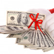 Royalty-Free Stock Photo: Money in hand of santa claus.