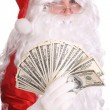 Stock Photo: Santa Claus holding money.