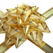 Gold bow and ribbon. — Stock Photo