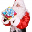 Santa Claus giving gift box. — Stockfoto