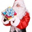 Santa Claus giving gift box. — Stock Photo