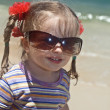 Girl in sunglasses at sea coast. - Stock Photo