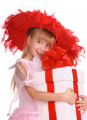 Girl in the red hat and the box. — Stock Photo